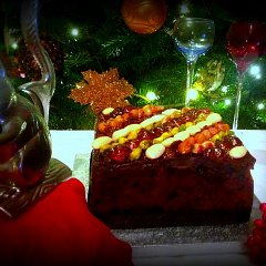 Chocolate slab Christmas cake, topped with glazed nuts and fruit