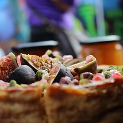 Figs, pistachios and pomegranate seeds adorn this baked cheesecake