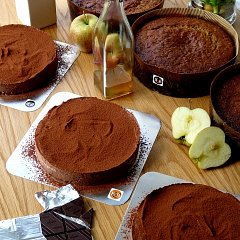 Three chocolate tortes, with some and spiced apple and medlar cakes