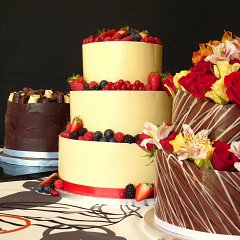 Three Brett & Bailey tiered cakes, each featuring exquisite chocolate work