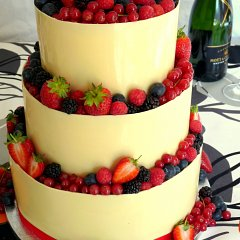 Five different types of berry adorn this wedding cake