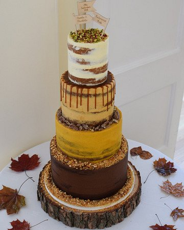 4-tier multi-flavour semi-naked wedding cake