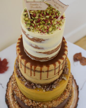 Close up of 4-tier multi-flavour semi-naked wedding cake