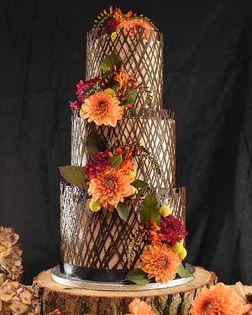 Wedding cake with dahlias and chocolate cage